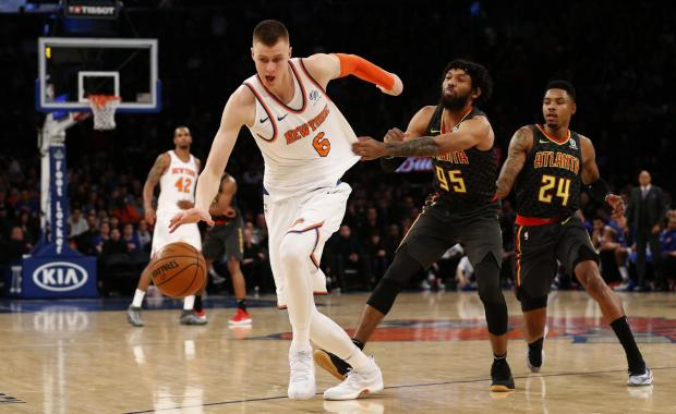 New York Knicks forward Kristaps Porzingis (6) is fouled by Atlanta Hawks forward DeAndre' Bembry (95) during the fourth quarter at Madison Square Garden. Photo: Noah K. Murray-USA TODAY Sports.
