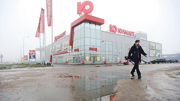 A man walks close to a distribution point of Russia's online retailer Ulmart in St Petersburg, Russia. Photo: AFP