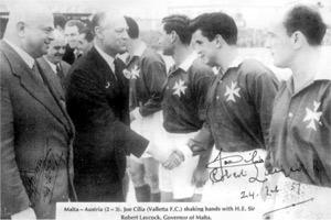 Governor Sir Robert Laycock shaking hands with Joe Cilia before the start of Malta`s first international match against Austria on February 24, 1957.