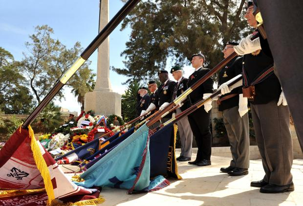 Flag bearers commemorate Anzac day at Ta'Braxia cemetery on April 25. Photo: Chris Sant Fournier
