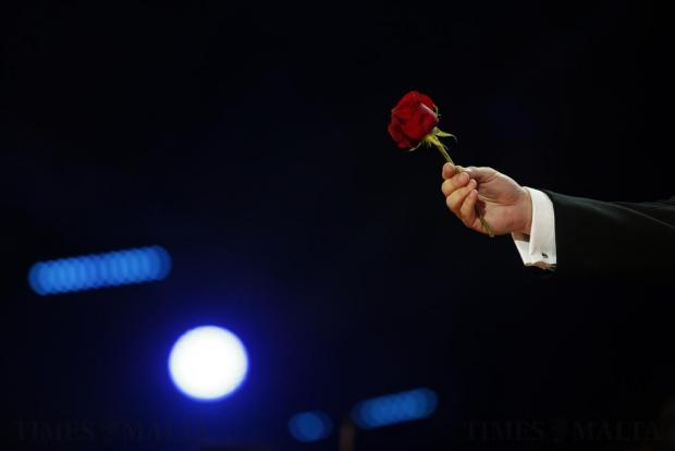 World-renowned tenor Joseph Calleja holds a red rose while performing excerpts from the opera Carmen during his concert on the Granaries in Floriana on July 28. Photo: Darrin Zammit Lupi