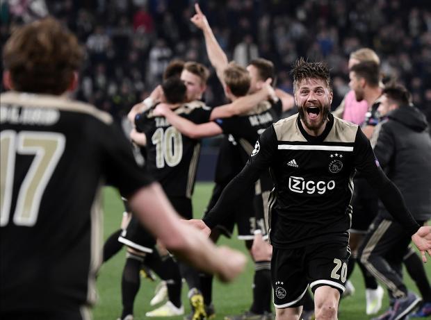 Ajax's Danish midfielder Lasse Schone (right) celebrates at the end.