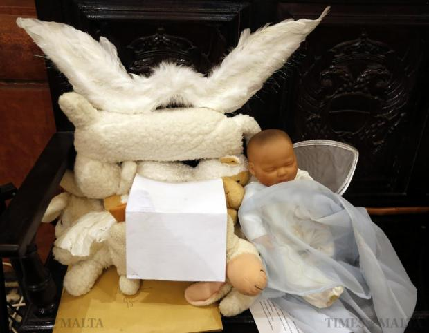 A life-like doll used in a Nativity play is placed on a bench during a mass at St John's Co-Cathedral which started off the fundraiser campaign Milied Flimkien on December 10. Photo: Darrin Zammit Lupi