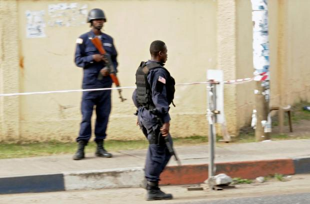 Anti-Riot police officers are seen at the National Election Commission headquarters in Monrovia