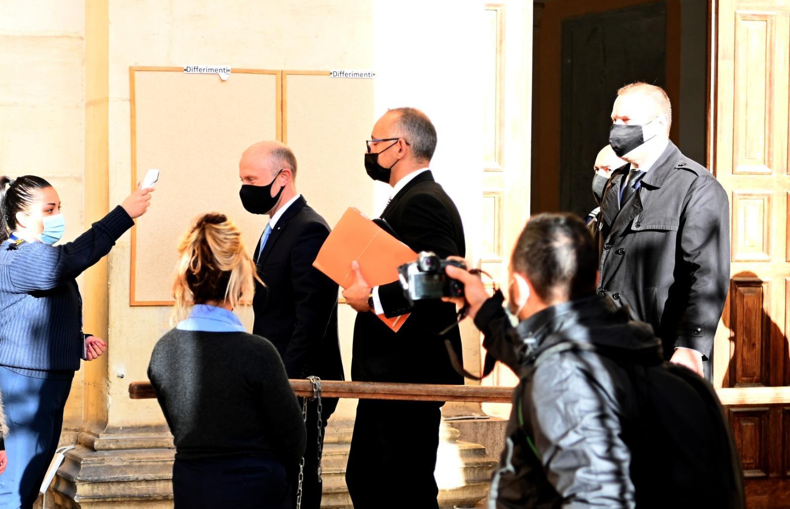Joseph Muscat makes his way into court. Photo: Mark Zammit Cordina
