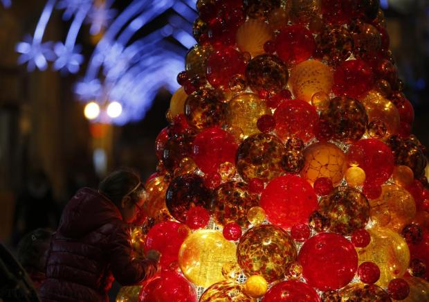 A girl looks at a Christmas tree made of glass baubles in Valletta on December 20. Photo: Darrin Zammit Lupi