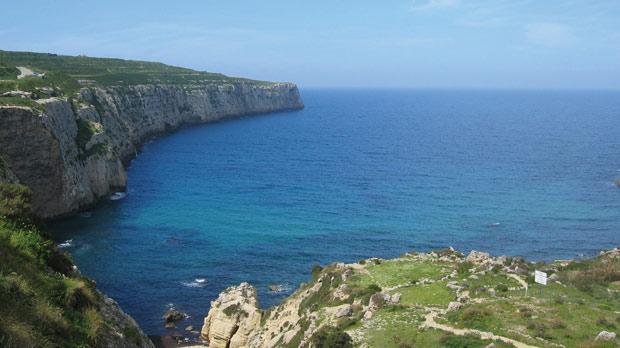 Fomm ir-Riħ Bay, with the remote Punico-Roman headland of Ras ir-Raħeb on the left.