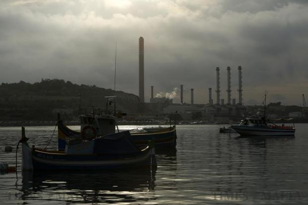 Fishing boats are seen in Marsaxlokk in front of the Delimara power station in the early morning of October 10. Photo: Darrin Zammit Lupi