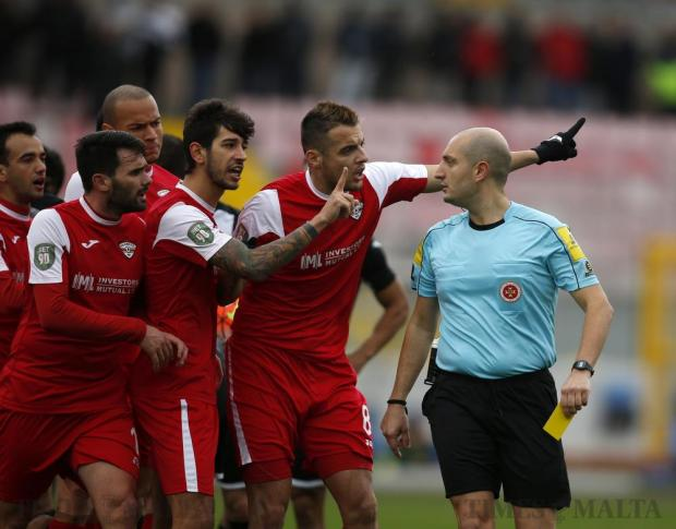 Balzan's players remonstrate with referee Glen Tonna during the Premier League football match against Hibernians at the National Stadium in Ta'Qali on December 17. Photo: Darrin Zammit Lupi