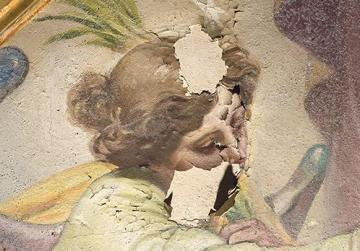 Detail in raking light of the face of the angel in the central vault painting. Large flakes can be seen hanging from the edge of a large loss in the face. Once placed back, key elements of the angel's face could once again be read, facilitating the reconstructing of the lost area.