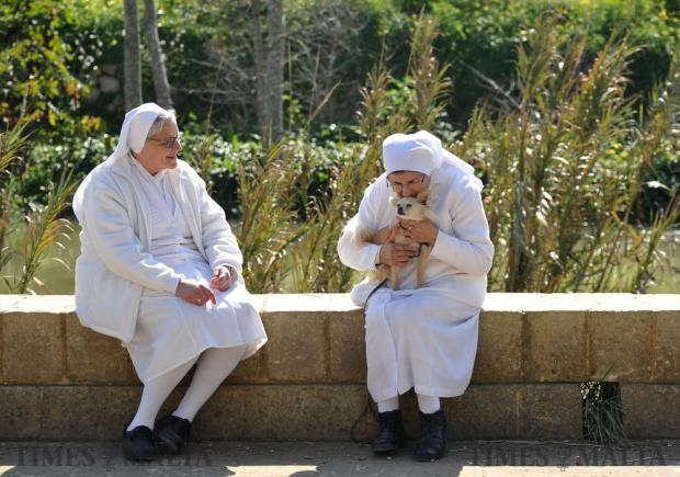 Two Ursuline sisters from the congregation of St Angela Merici take in the winter sunshine at Chadwick Lakes on February 15. Photo: Chris Sant Fournier