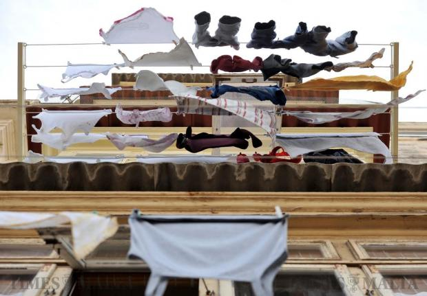 Clothes hang to dry from a traditional Maltese balcony in Valletta on October 5. Photo: Chris Sant Fournier