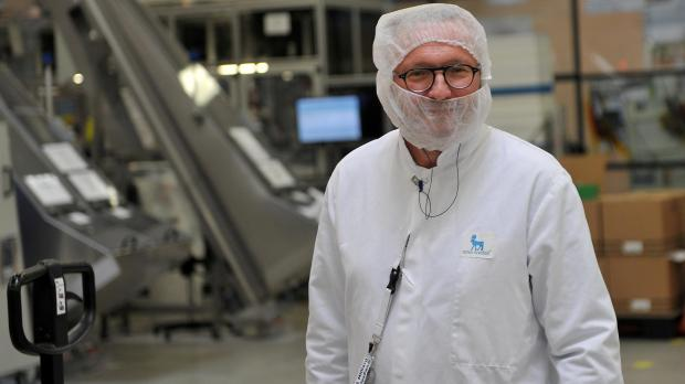 An employee poses at the insulin production plant of Danish multinational pharmaceutical company Novo Nordisk in Chartres.