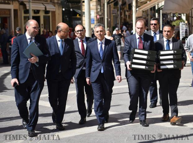 Nationalist Party leader Simon Busuttil walks down Republic street in Valetta to the Law Courts carrying eight box files containing new evidence against Prime Minister Joseph Muscat's chief of staff Keith Schembri on May 19. Photo: Mark Zammit Cordina