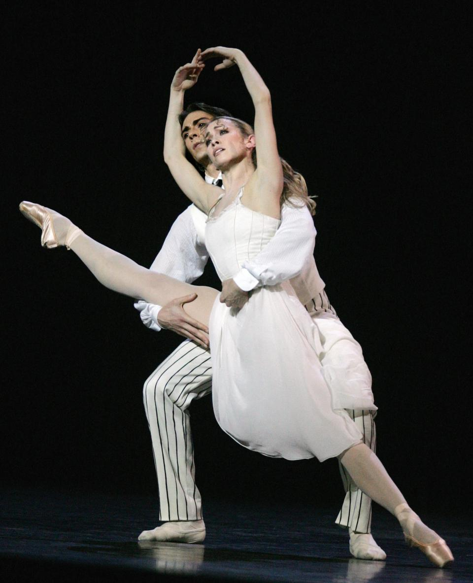 Dancers Eleonora Abbagnato and Herve Moreau performing during a rehearsal of a show by choreographer Roland Petit, 'Proust ou les intermittences du coeur' (Proust or intermittencies of the heart) at the Paris Opera in February 2007. Photo: Dominique Faget/AFP