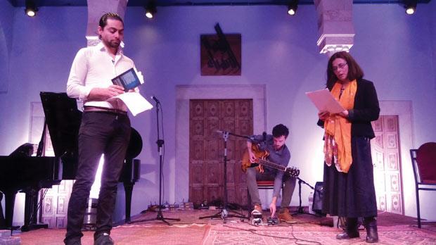 Norbert Bugeja reciting his poetry with Greco-Tunisian actress Helene Catzaras.