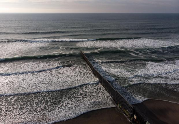 An aerial view of the US-Mexico border fence seen from Playas de Tijuana, Baja California state.