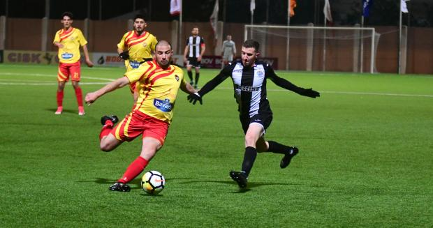 Randall Vella (left) of Senglea Athletic tussles for the ball with Hibernians' Jurgen Degabriele. Photo: Jonathan Borg