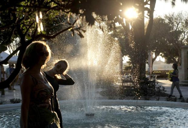 Tourists walk past a backlit fountain at the Upper Barrakka Garden in Valletta on November 9. Photo: Chris Sant Fournier