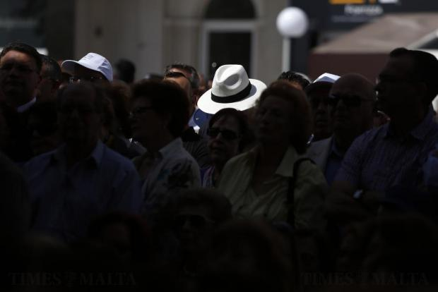 A man wears a Panama hat while attending a Nationalist Party meeting in Sliema on April 17. Photo: Darrin Zammit Lupi