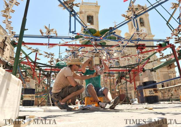 Men work on a Catherine wheel before the feast of St Philip in Zebbug on June 15. Photo: Chris Sant Fournier