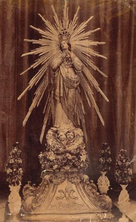 A 19th century photo showing the statue adorned with a silver aureole made in 1874 and mounted on a wooden plinth sculptured by Mariano Gerada in 1804.