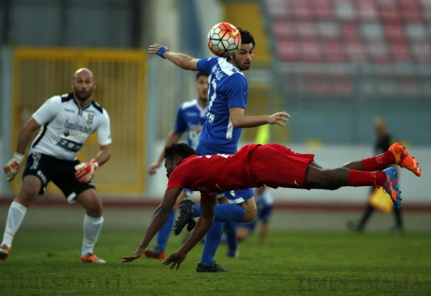 Obinna Obiefule (front) of Pembroke Athleta dives to try reach the ball as Pieta Hotspurs' James Gorske looks on during their FA Trophy quarter-final at the National Stadium in Ta' Qali on April 20. Photo: Darrin Zammit Lupi