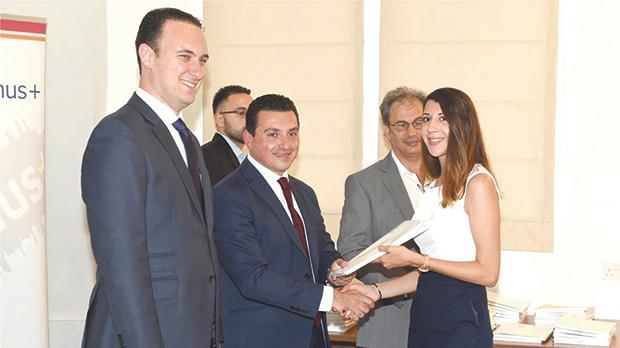 Aaron Farrugia presenting a grant to a representative of one of the benefiaries in the presence of Clifton Grima. Photo: Pierre Sammut/DOI