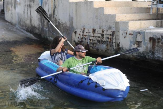 Activists from Front Emergenza Ambjent use canoes to make their way to Manoel Island for a protest on September 23. Photo: Steve Zammit Lupi