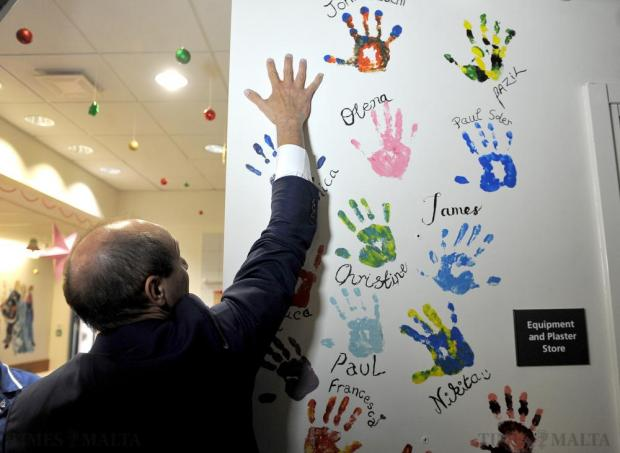 Health Parliamentary Secretary Chris Fearne leaves his hand print on the wall of the newly-opened Children's Accident and Emergency wing at Mater Dei Hospital on December 21. Photo: Chris Sant Fournier