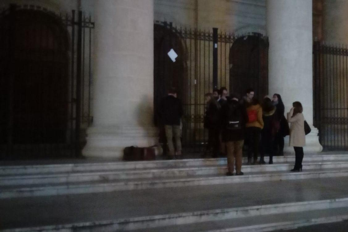 Reporters wait outside the law courts building in Valletta.