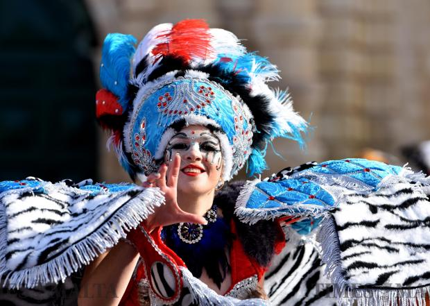 A woman dressed in costume performs on stage in St George's Square, Valletta during carnival on February 11. Photo: Mark Zammit Cordina