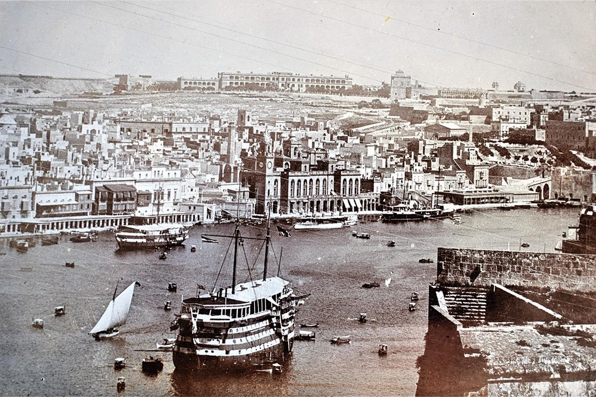 The Vittoriosa waterfront in the 1880s. HMS Hibernia is in the foreground.