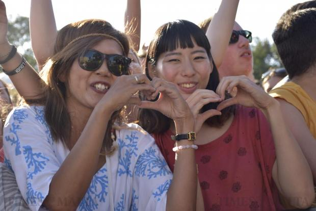 Two concert-goers make a heart shape sign at the Isle of MTV concert on the Granaries in Floriana on June 28. Photo: Mark Zammit Cordina