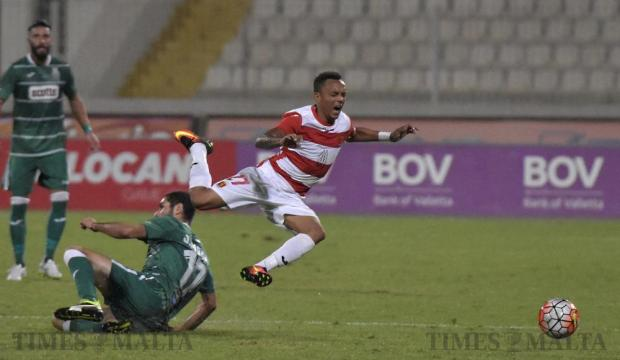 Valletta's Jhonnattann is tackled by Floriana's Jurgen Pisani during their Premier League football match at the National Stadium in Ta' Qali on September 21. Photo: Mark Zammit Cordina