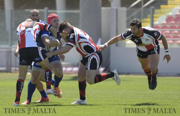 Maltese rugby players try to stop an Israeli Player during the European Nations Cup – Conference 1 South qualifying group match held at the Hibernians Stadium in Paola on April 22. Photo: Mark Zammit Cordina