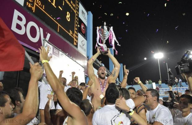 St Julian's team captain Matthew Zammit Lift the league trophy after the final match of the waterpolo league between St Julian's and Neptunes at Tal-Qroqq National Pool on August 29. Photo: Mark Zammit Cordina