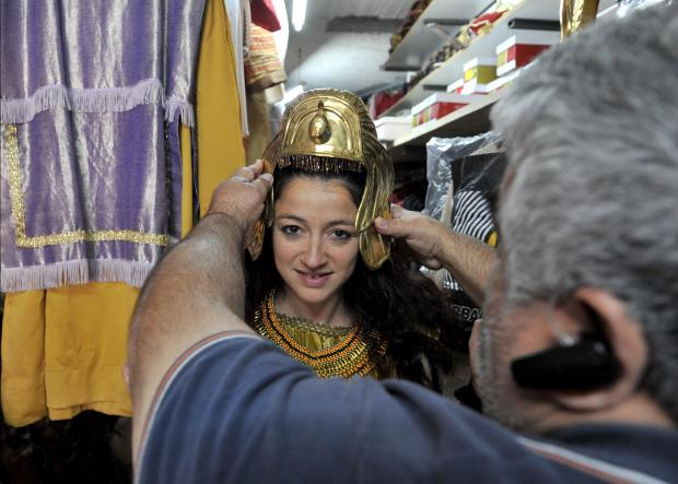 A woman tries on her costume which will be worn at the Good Friday procession in Zebbug. March 26. Photo: Chris Sant Fournier