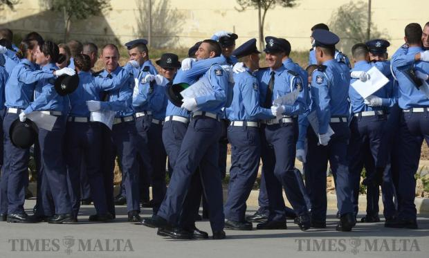 New police recruits celebrate after their passing-out parade at the Police Academy in Ta' Kandja on October 21. Photo: Matthew Mirabelli