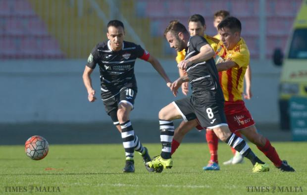 Balzan's Paul Fenech (centre) boots the ball up field during their BOV Premiership Match against Birkirkara at the National Stadium in Ta'Qali on February 6. Photo: Matthew Mirabelli . Photos: Matthew Mirabelli