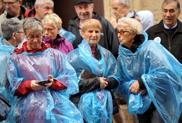 Tourists wearing plastic raincoats tour Valletta on November 16. Photo: Chris Sant Fournier
