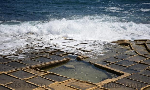 Waves break on a chequerboard of rock-cut saltpans at Baħar iċ-Ċagħaq on June 26. . Photo: Mark Zammit Cordina