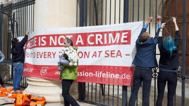 Activists demonstrate outside the courts in Valletta ahead of the hearing. Photo: Chris Sant Fournier.
