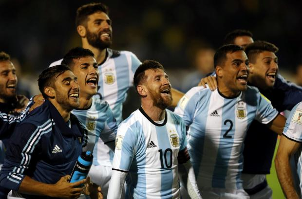 Argentina's Lionel Messi and teammates celebrate at the end of the match.