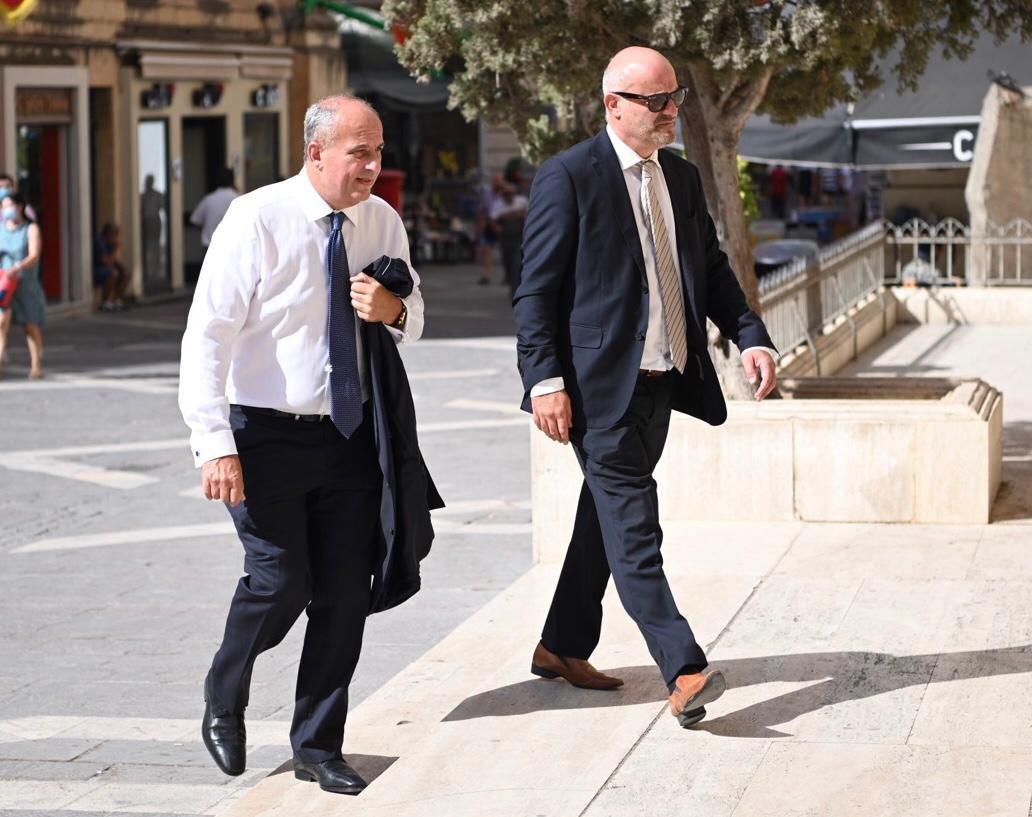 Dr Adrian Vella (left) entering court on Tuesday. Photo: Mark Zammit Cordina.