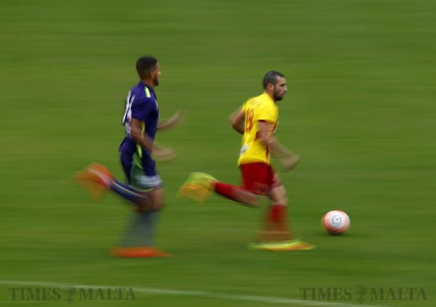 Birkirkara's Joseph Zerafa (right) advances down the flank as St Andrews' Kyrian Nwoko gives chase during their Premier League football match at the National Stadium in Ta' Qali on November 19. Photo: Darrin Zammit Lupi