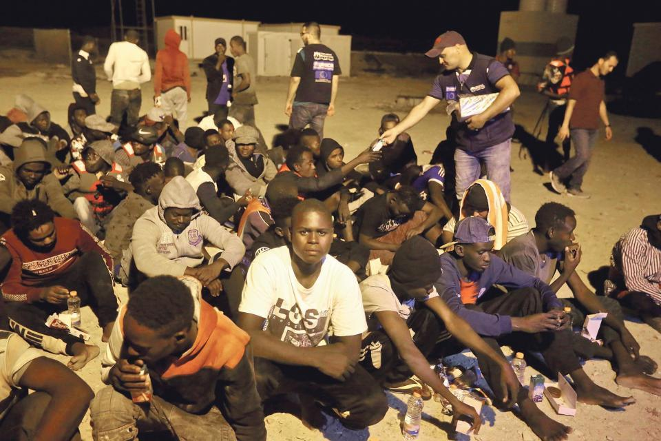 Libya is not considered a safe port by the United Nations and detention camps there have regularly been linked to severe human rights breaches. Picture shows rescued African migrants in the Libyan town of Khoms. Photo: AFP