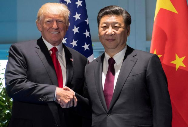 Donald Trump with Xi Jinping. Photo: Reuters