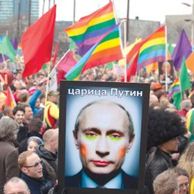 A demonstrator holds up a picture depicting Russian President Vladimir Putin with make-up, yesterday. Photo: Reuters