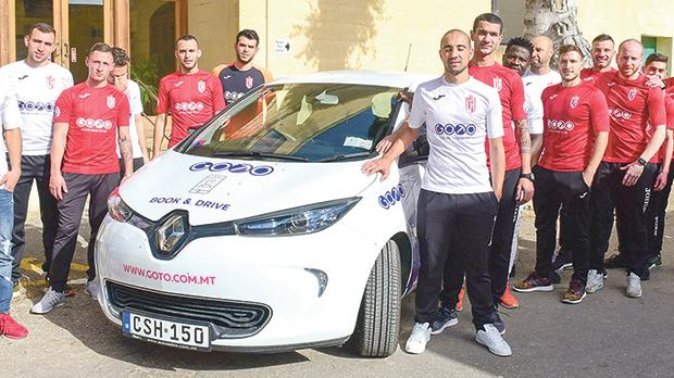 Victoria Hotspurs with one of the GoTo cars.
